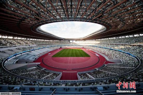 资料图:2020年东京奥运会和残奥会主场馆日本国立竞技场举行竣工仪式。