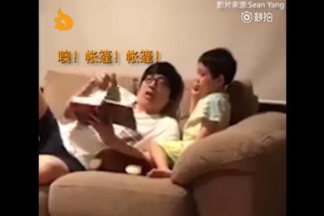 老爸给孩子讲故事超敷衍 三十秒读完一本书
