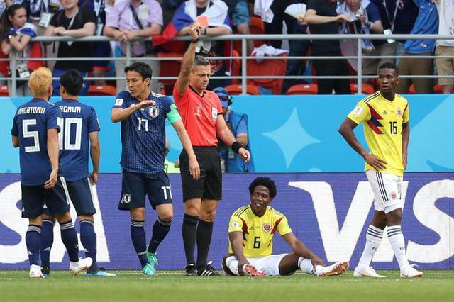 世界杯首张红牌 开场3分钟 日本对手手球+送点