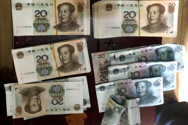 """安徽一""""钞级大骗""""伪造675张纸币"""