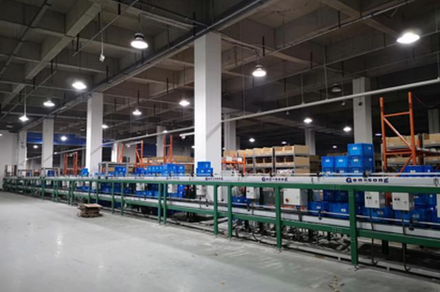 """安徽邮政智能仓:机器人助力""""双十二""""订单精准速效"""