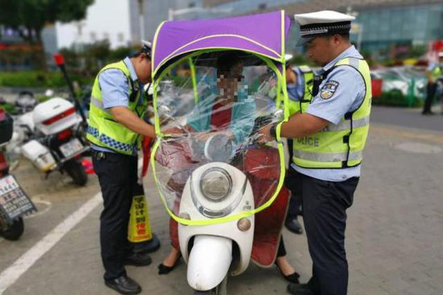 马鞍山强力整治电动自行车遮阳篷!拒拆的罚款后强拆