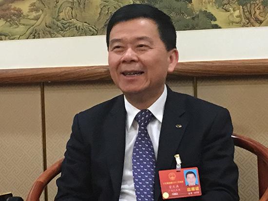 第十三届全国人大代表、广汽集团党委书记、董事长曾庆洪 王跃跃 摄