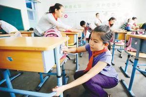 中国小学生日均劳作12分钟 为美国小学生六分之一
