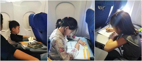 飞机上补作业的孩子们