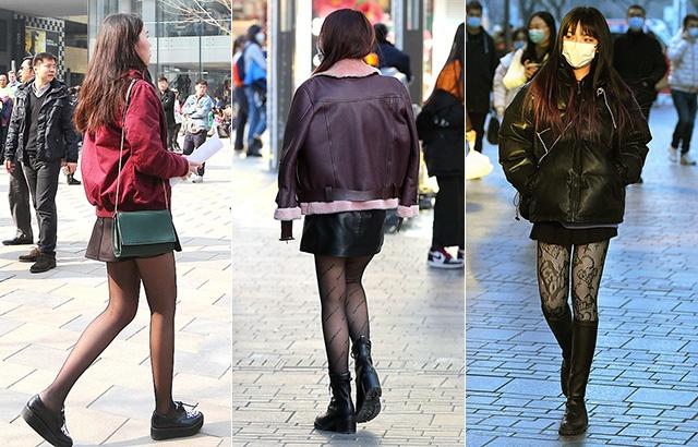 街拍:乍暖还寒,潮女大秀美腿