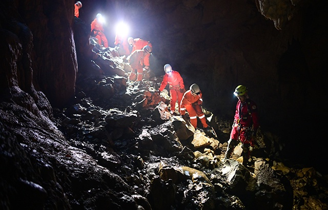 Go deep into the underground inverted world of Guizhou and explore the magic caves