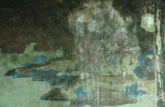 东千佛洞第二窟北壁西侧唐僧取经图中剥落部分露出下层壁画