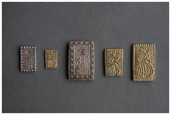 江户幕府时代货币:一朱银,二朱金,一分银,一分金,二分金(资料图)