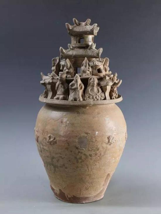青瓷佛像楼阁人物堆塑罐