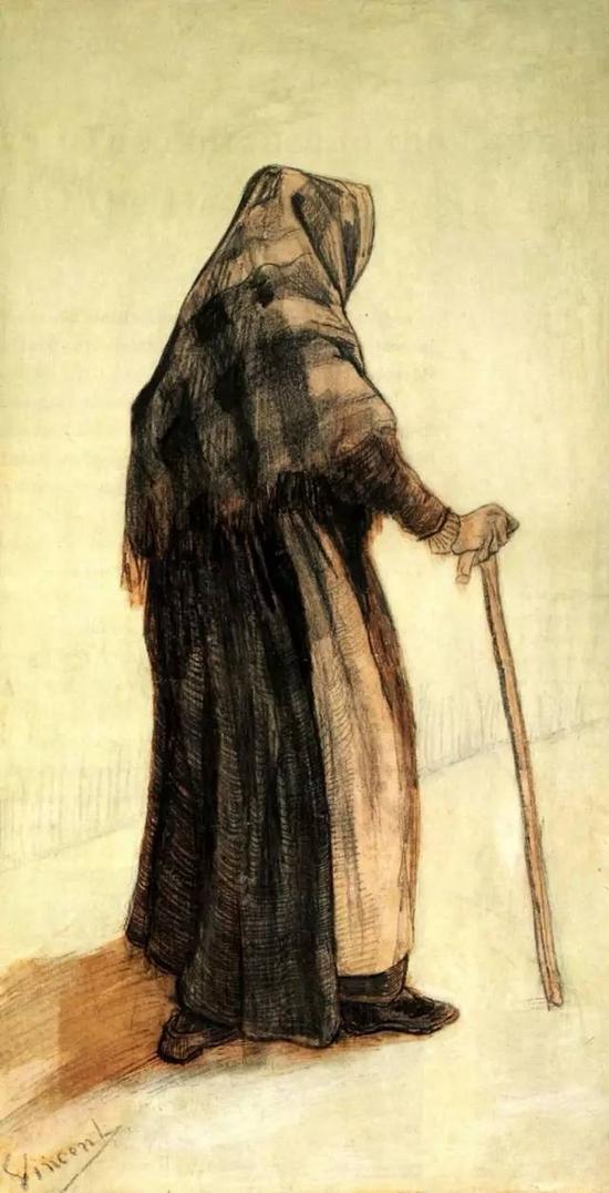 拄着拐杖围着披肩的老妇