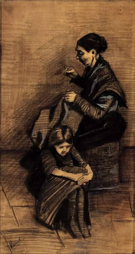 针织的女子和坐在地上的女孩
