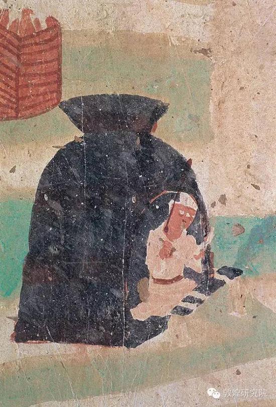 榆林窟第19窟-目连守孝-五代。壁画解读:孝子在草庐中守孝,面前案几上放经卷。