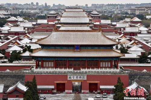 资料图:雪后的紫禁城一片银装素裹。中新网记者 金硕 摄