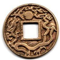 图8 铜鎏金(直径45mm 厚3.7mm 重34.2克)