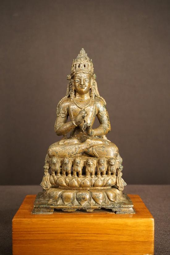 9世纪的一尊毗卢佛,为黄铜错银