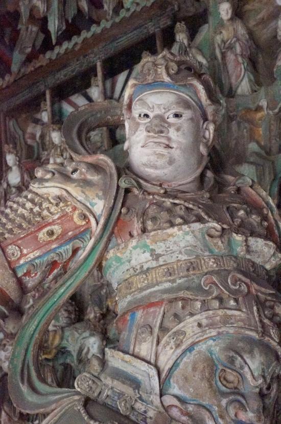 双林寺的韦陀像双目炯炯有神,身姿挺拔又具有动态,栩栩如生。