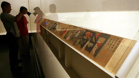 ▲南唐顾闳中最著名的《韩熙载夜宴图卷》