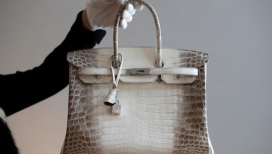 中国买家热情升温 线上竞标奢侈品一年翻12倍