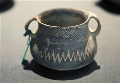 马家窑文化陶罐是马家窑文化的精品之作。新京报记者 浦峰 摄