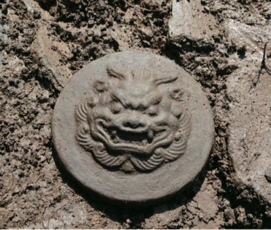 吉林宝马城遗址出土的兽面纹瓦当。(社科院考古所供图)
