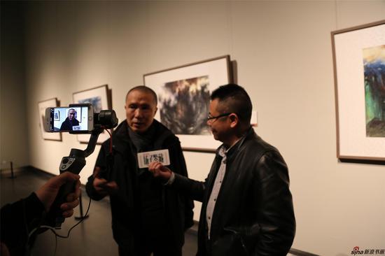 江苏省国画院院长周京新接受现场直播