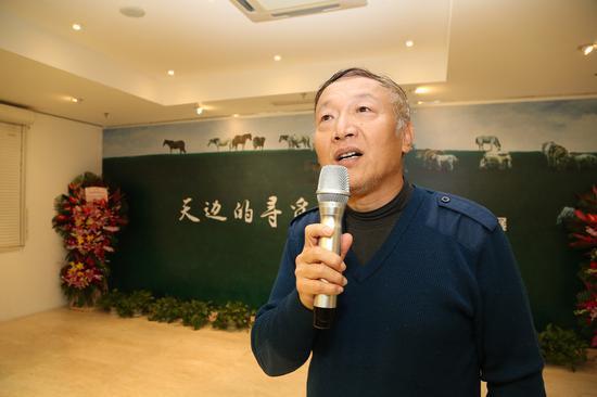 空军政治部创作员陈玉山在开幕式致辞