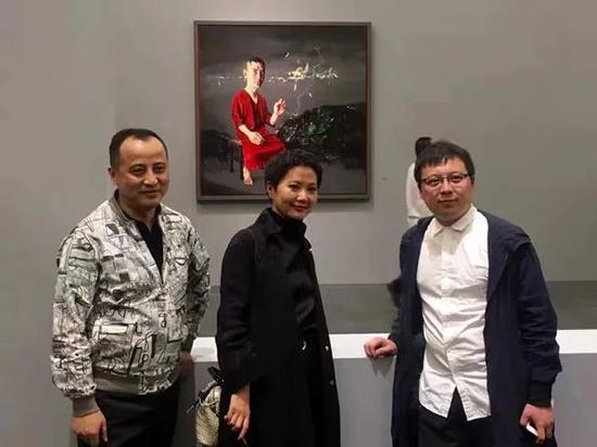刘宏剑与策展人江宁、艺术家周力