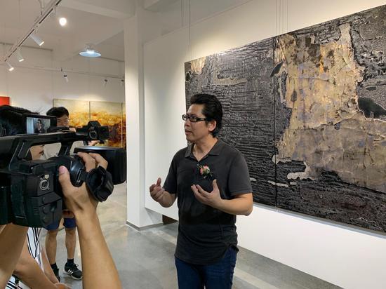 中国美术家协会理事、漆画艺术委员会副主任兼秘书长、福建省美术家协会副主席汤志义先生接受采访