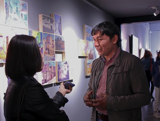 库尔班江·吾拉木艺术展在京开幕