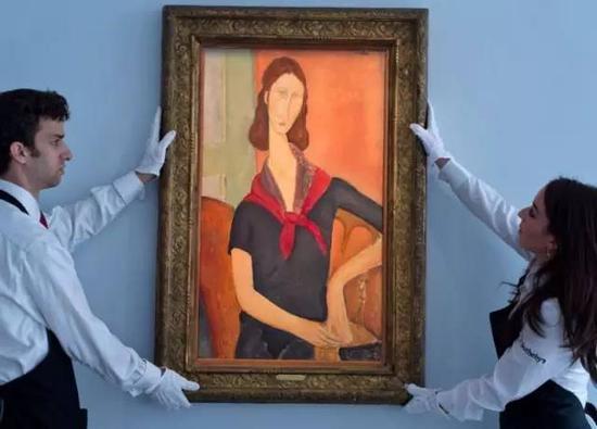 莫迪里亚尼《戴围巾的珍妮‧埃布特尼》,1919年,图片来源:苏富比/Getty Images