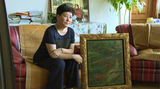 刘蟾女士的解读在画面之外充满了家庭回忆
