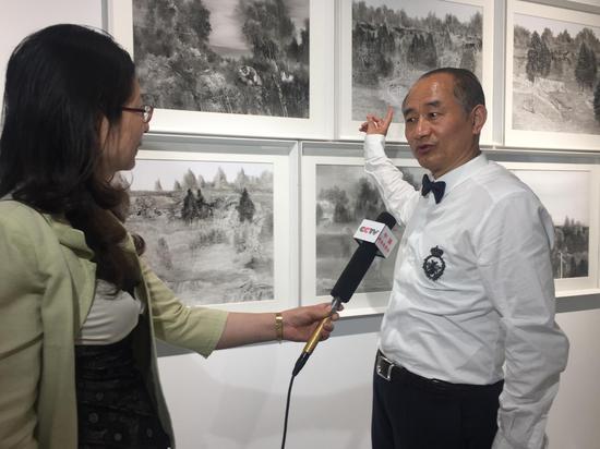 严陆根接受中央电视台采访