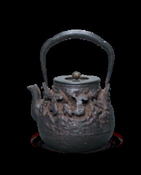 江户时期 龙文堂造荒岩肌长闲形铁壶