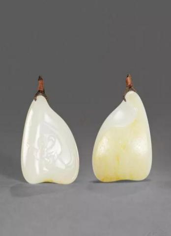 王一卜 和田玉籽料天乐挂件    尺寸:4.8×3.9×1.4cm 37g