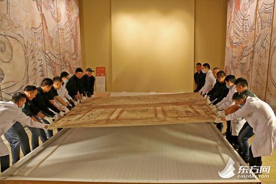 """图片说明:来自山西博物院宽3.2米,高3.5米的""""忻州九原岗北朝壁画墓墓道北壁""""壁画。"""