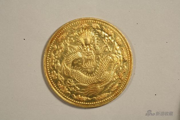 235b丁未大年夜清金币一两,重量36、2克,直径38、9毫米。
