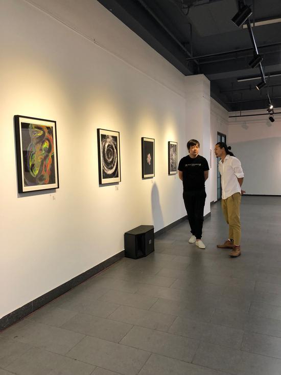 收藏家贺雷、雕塑家王秉辉先生