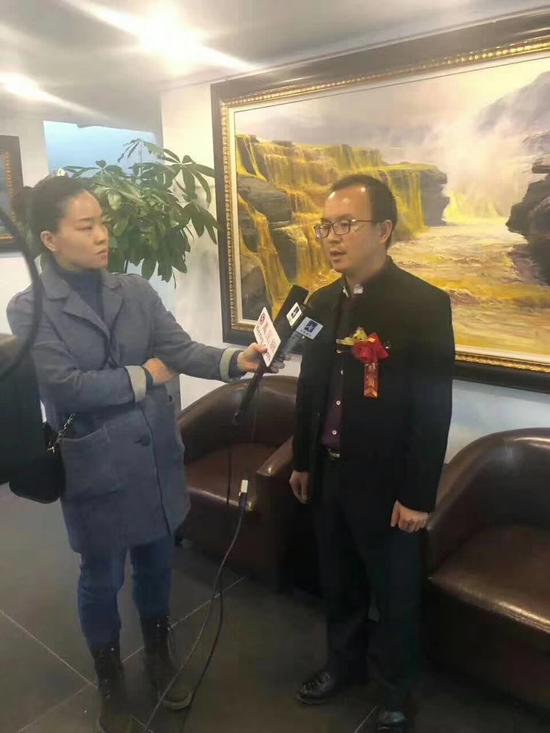 北京九藏天下文化发展有限公司总经理王家兴接受媒体采访