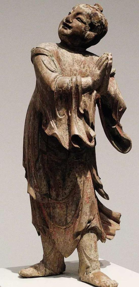 参阅:明代木胎善财童子像,藏于美国大都会博物馆