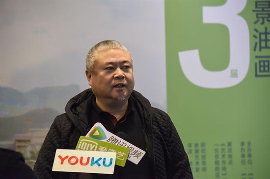 研究班导师王文生接受采访