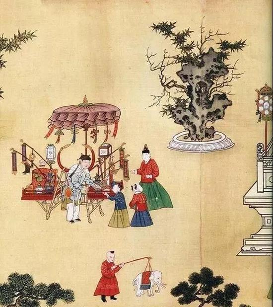 《宪宗元宵行乐图》(局部),卖花灯的货郎车,孩子正在买各式各样的彩灯。