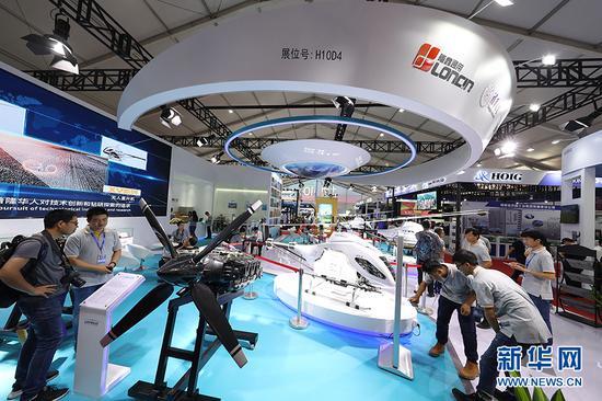 图为重庆隆鑫通用动力股份有限公司展台现场。