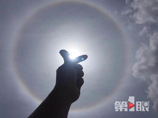 △15日,北碚上空出现的日晕。图片来源:第1眼