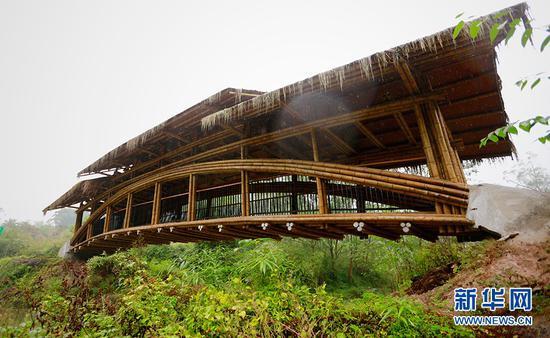 """""""一心桥""""是一座农村现代竹桥,使用寿命可达20年。新华网 彭博 摄"""