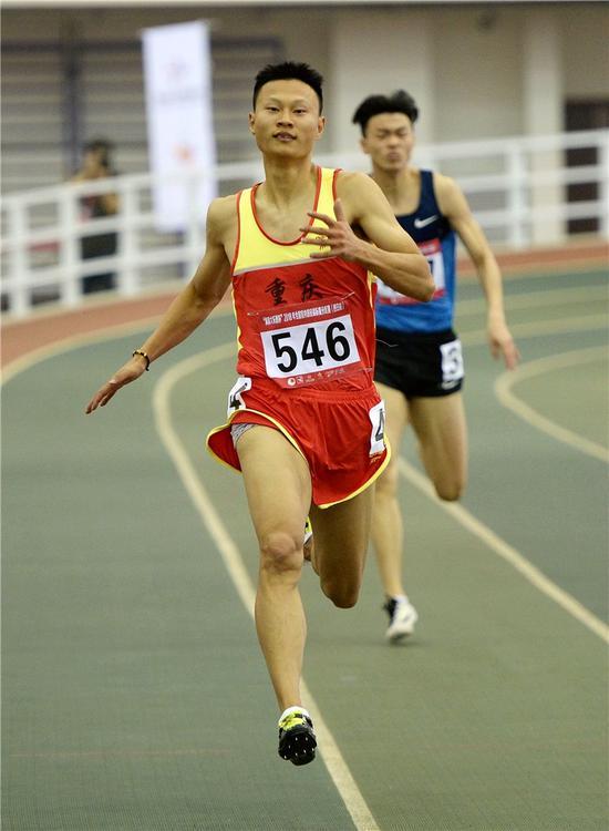 △重庆选手别舸在男子200米决赛中,以21秒04的成绩获得冠军。新华社发