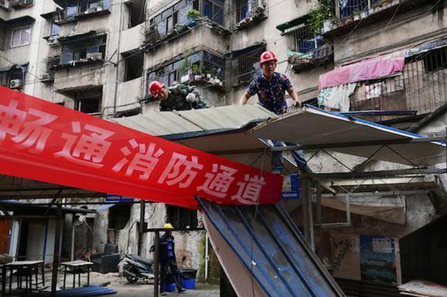九龙坡龙泉村露天市场正式启动拆除 将变身休闲广场