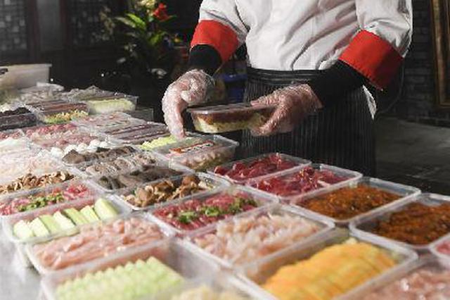 疫情期间火锅外卖服务受青睐 有门店一天接500订单