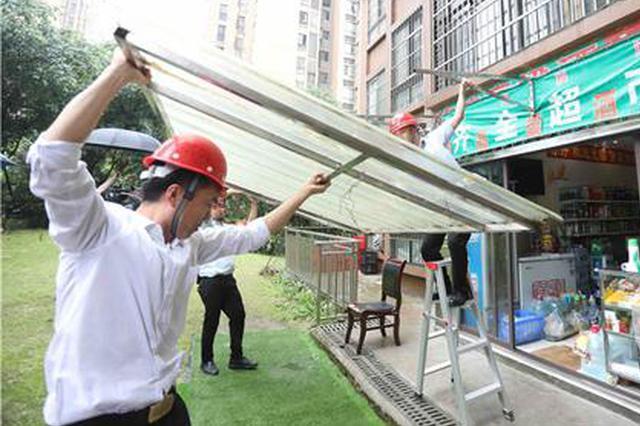 高层建筑还在用可燃雨棚?今年12月底前完成拆改