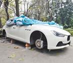 团伙盗走豪车4个轮胎